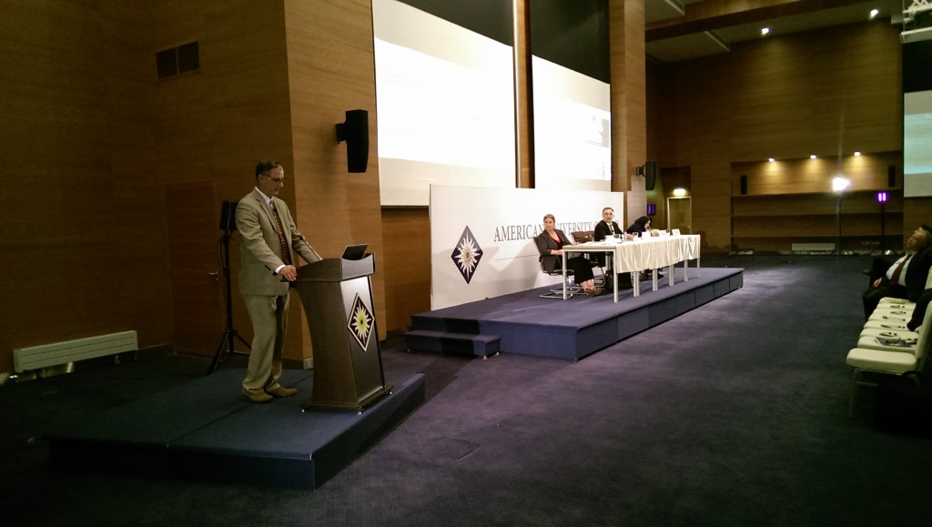 Left to right: Abdulameer al-Hamdani presenting at AUIS, with Geraldine Chatelard, Mahmood Ahmed Bakr Khayat, and Leila Salih in the Background (Peter Wien, 2016))