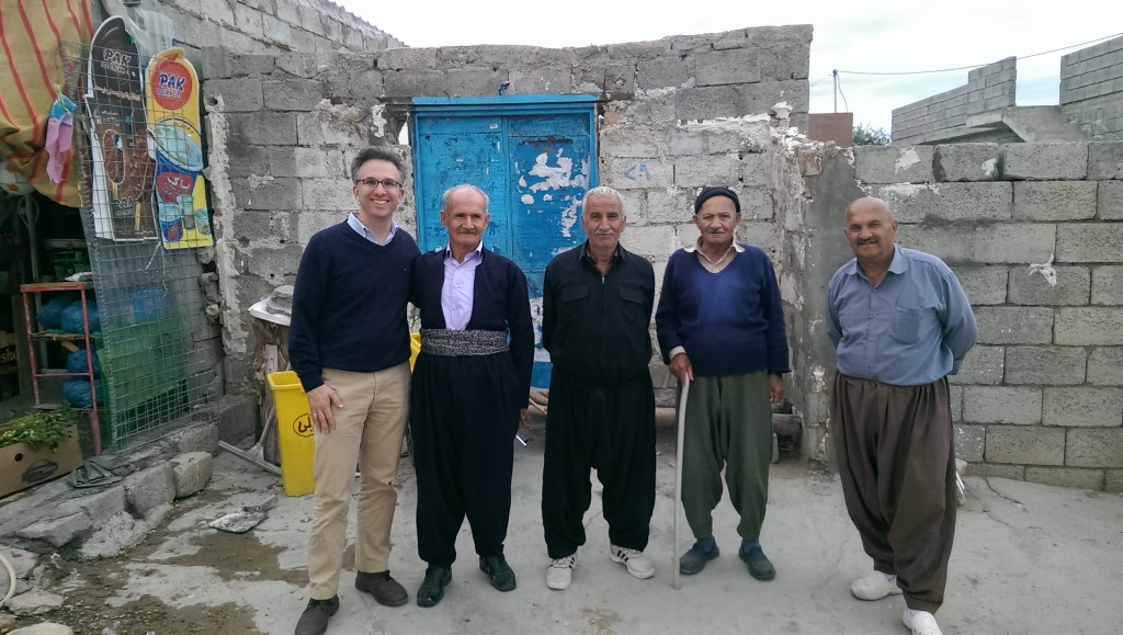 Peter Wien (left) with Village Elders (Wien, 2016)